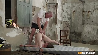 Slim twink endures age-old man's calumnious punishment with respect to serious anal BDSM play