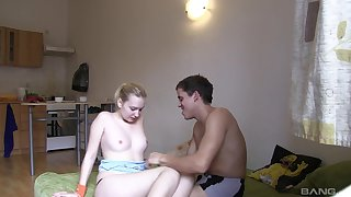 Pale blonde cutie Monika L gives stranger a kinky clothed handjob